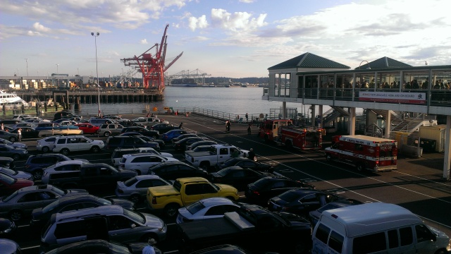 Cars wait to board a ferry. The SFD left shortly before sailing, an apparent medical situation resolved.