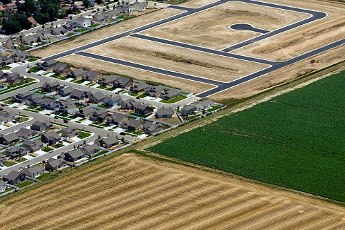 Urban sprawl into farmland. Near Longmont, CO. Photo by John Wark. (airphotona.com)