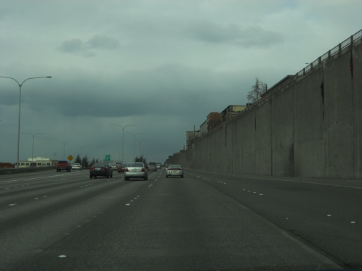 I-5 through Seattle has long stretches of retaining walls that could be built over.