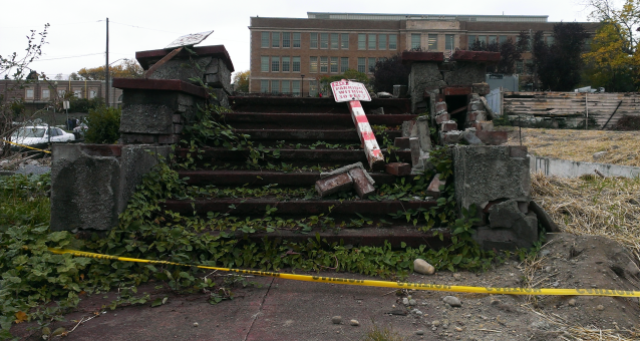 The stoop of a demolished single-family house. (Photo by the author)