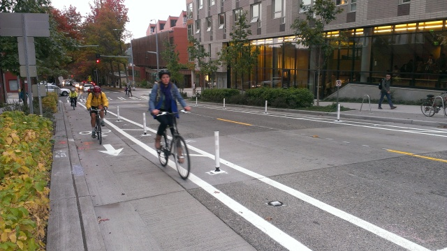 Bicyclists ride the new protected bike lanes on northbound Brooklyn Avenue NE. (Photo by the author)