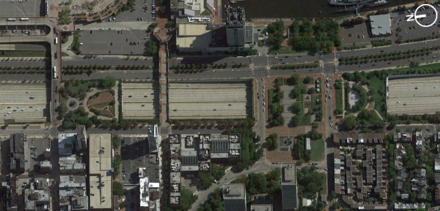 An aerial of Philadelphia's two existing lid parks and the South Street pedestrian bridge just steps from its riverfront. (Screenshot from Google Earth)