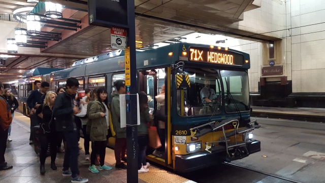Riders boarding one of the last 71s to run in the transit tunnel Friday night. (Photo: author)