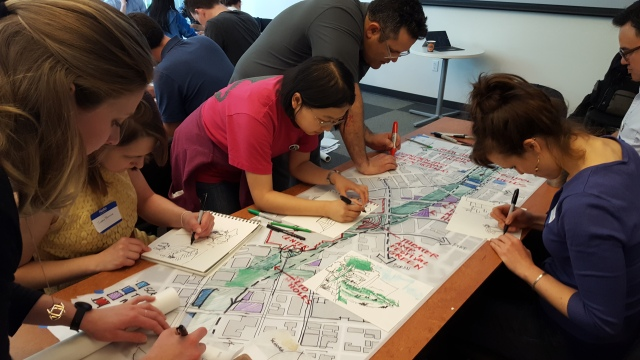 Another charrette team sketches out their design concept. (Photo by the author)