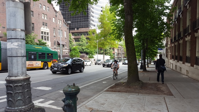 The existing unprotected bike lane on 4th Avenue between S Washington Street and Spring Street. (Photo by the author)